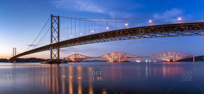UK- Scotland- Fife- Edinburgh- Firth of Forth estuary- Forth Bridge and Forth Road Bridge at sunset