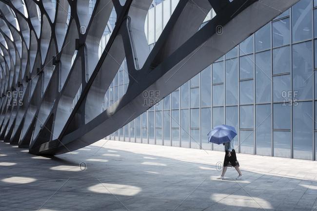 China- Shenzhen- modern architecture and walking woman
