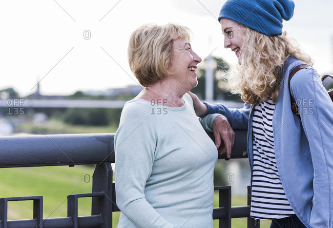 Happy grandmother and granddaughter face to face