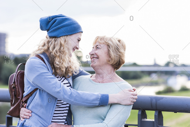 Happy grandmother face to face with her granddaughter