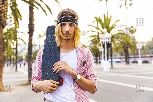 Portrait of serious skateboarder