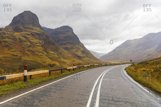 UK- Scotland- scenic road through the mountains in the Scottish highlands near Glencoe with a view on the Three Sisters