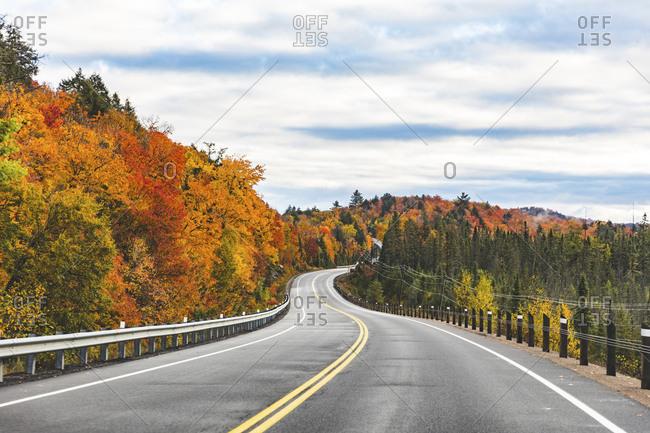 Canada- Ontario- main road through colorful trees in the Algonquin park area