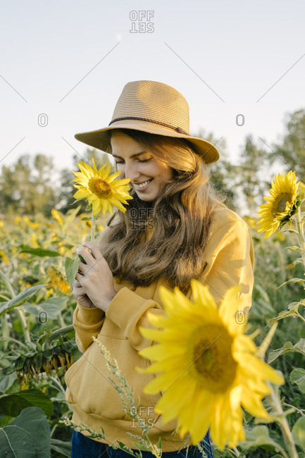 Portrait of a beautiful young woman holding a sunflower