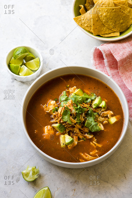 Overhead view of a bowl of chicken tortilla soup