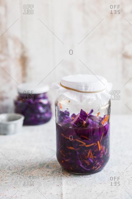 Kimchi fermenting in a jar