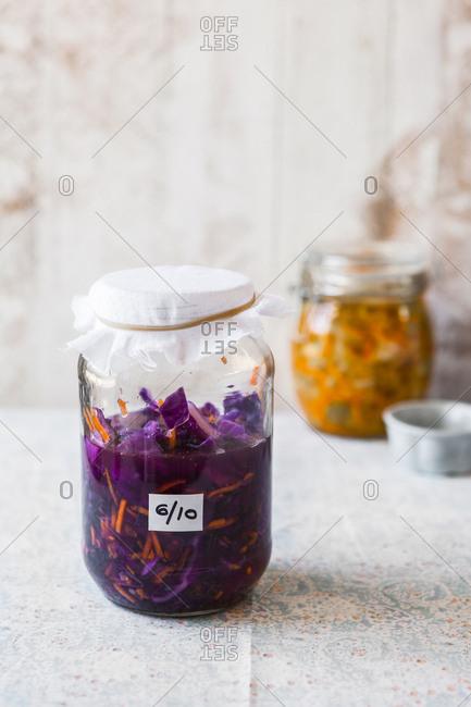 Fermenting purple cabbage kimchi in a jar