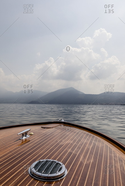 Front of a boat facing mountains