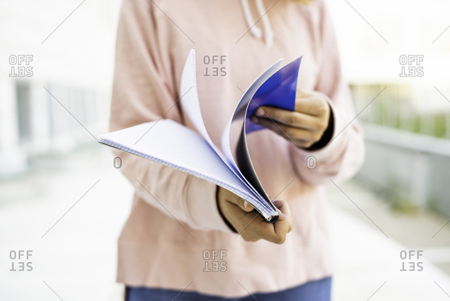 Woman flipping through notebook pages