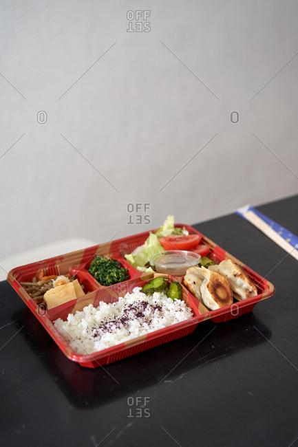 A take away bento box on a kitchen top