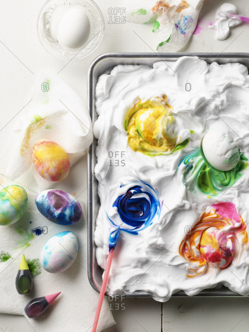 Shaving cream and food coloring for dying Easter eggs
