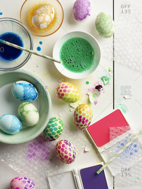 Decorated Easter eggs with bowls of watercolors