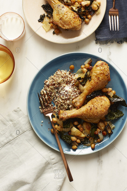 Chicken served with chickpeas, baked kale, and quinoa