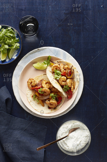 Shrimp tacos served with yogurt sauce, cilantro, and lime