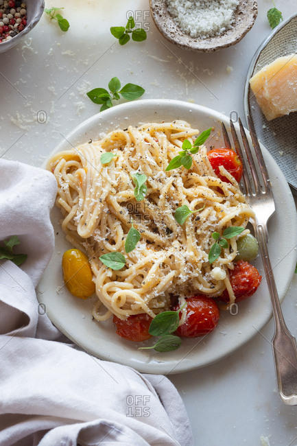 Plate of gluten free pasta with tomato and parmesan