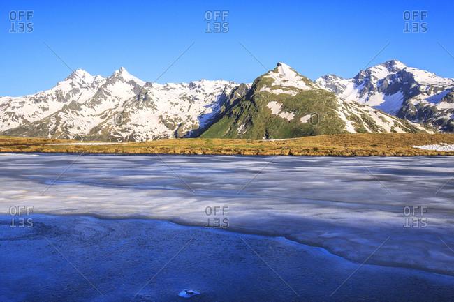 Ice melting at Lake Andossi during thaw, Chiavenna Valley, Spluga Valley, Sondrio province, Valtellina, Lombardy, Italy, Europe