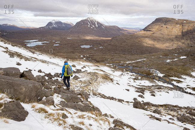 April 1, 2018: Hiking in the Scottish Highlands in Torridon along The Cape Wrath Trail near Loch Coire Mhic Fhearchair, Highlands, Scotland, United Kingdom, Europe