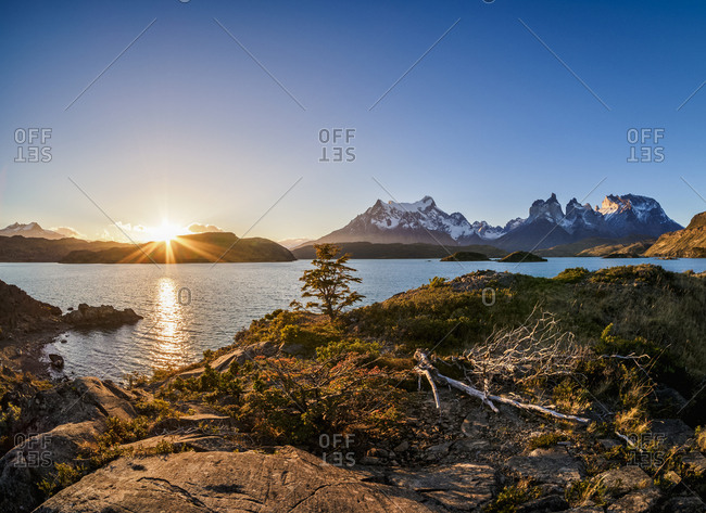 View over Lake Pehoe towards Paine Grande and Cuernos del Paine, sunset, Torres del Paine National Park, Patagonia, Chile, South America