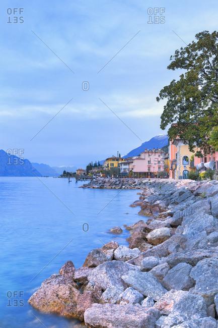 April 2, 2018: Soft lights at dusk at the village of Macugnano, Brenzone sul Garda, Lake Garda, Verona Province, Veneto, Italian Lakes, Italy, Europe