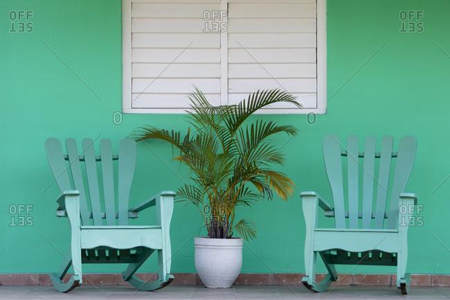 Green chairs on veranda, UNESCO World Heritage Site, Vinales, Pinar del Rio, Cuba, West Indies, Caribbean, Central America