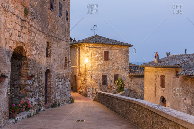 May 7, 2018: Dawn view of a street in San Gimignano, UNESCO World Heritage Site, Tuscany, Italy, Europe