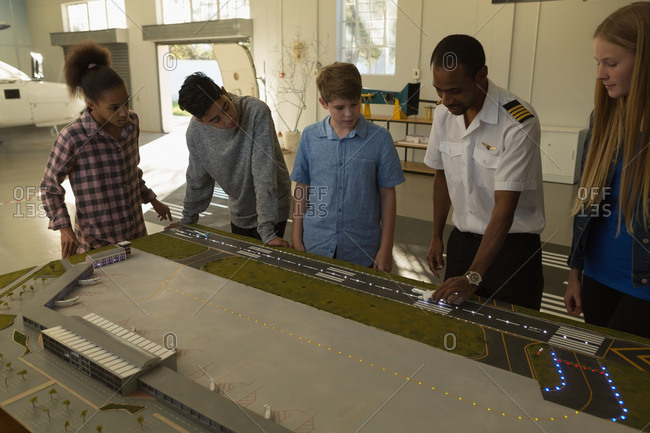Male pilot training about model plane in training institute