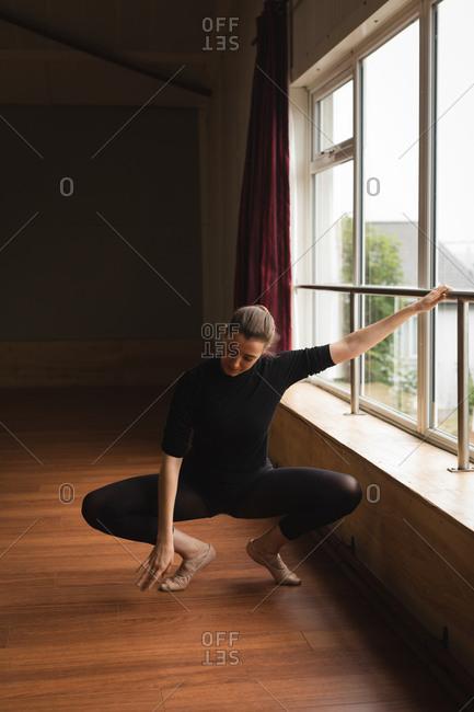 Ballerina practicing ballet dance in dance studio