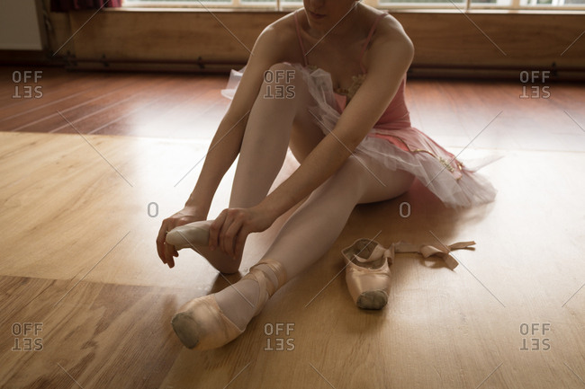 Ballerina wearing socks in dance studio