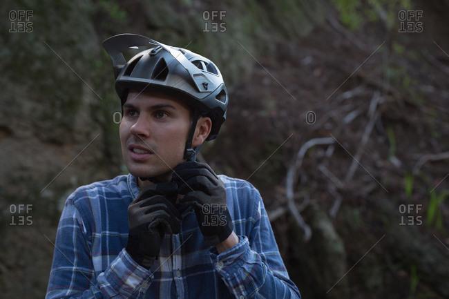 Young man wearing helmet on lane