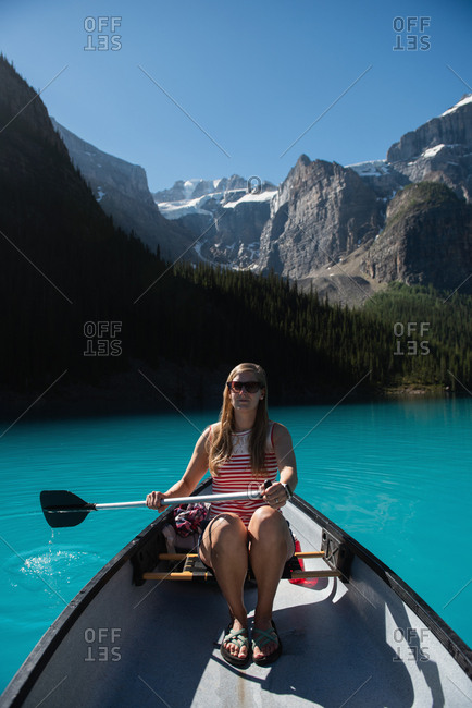 Beautiful woman riding boat in river