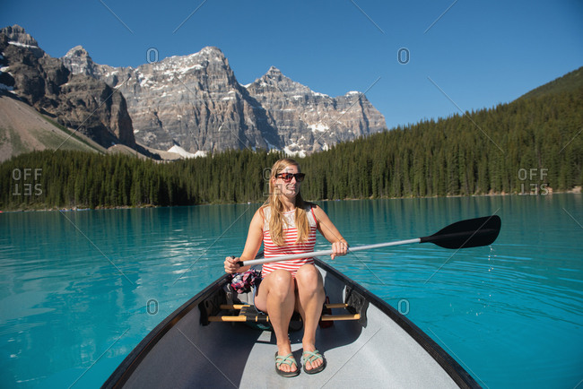 Woman boating in river on a sunny day