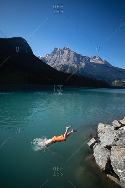 Man diving in river at countryside