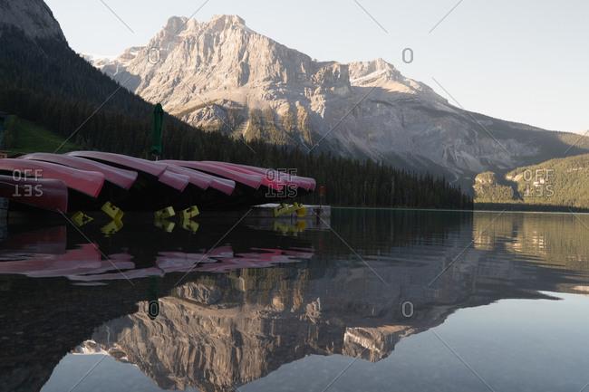 Boats kept upside down at river shore at countryside
