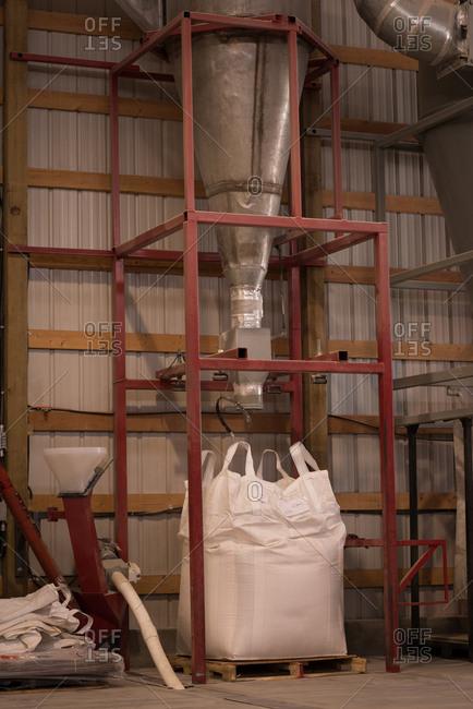 Modern granary machine in warehouse