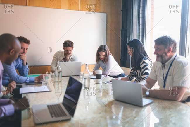 Business people working in conference room at office