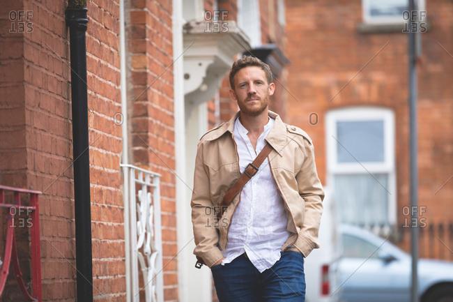 Smart man walking on side walk in the city