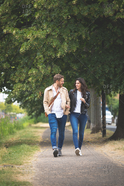 Romantic couple interacting while walking in street