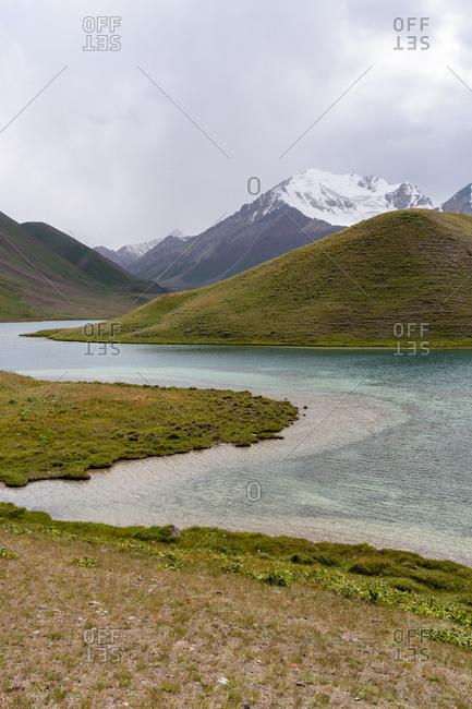 Snow-capped Lenin Peak and Lake Tulpar-Kol, Sary Mogol, Kyrgyzstan