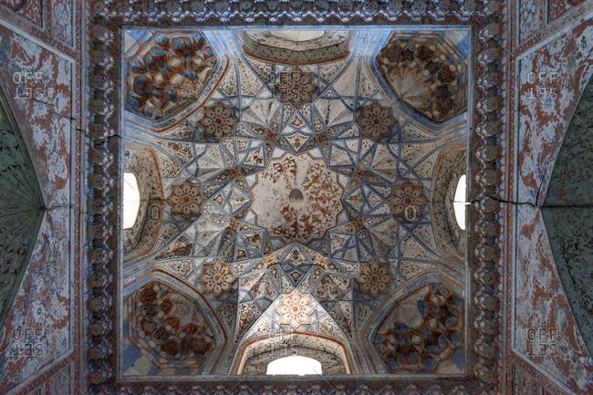 Bukhara, Uzbekistan - August 9, 2018: Ceiling inside the Abdul Aziz Khan Medressa