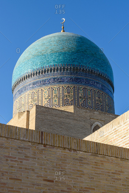 Bukhara, Uzbekistan - August 10, 2018: Blue dome of Mir-Arab-Madrasa