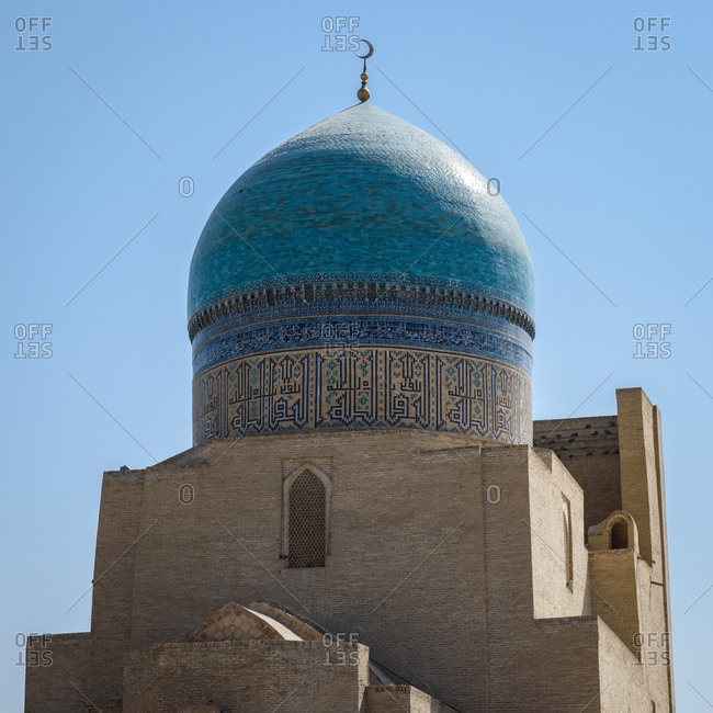 Bukhara, Uzbekistan - August 10, 2018: Blue dome of the Mir-Arab-Madrasa