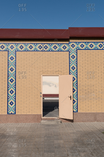 Samarkand, Uzbekistan - August 13, 2018: Building exterior with open door