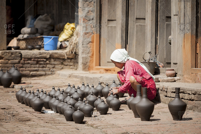 Kathmandu, Nepal - April 3, 2007: Vendor selling handmade pots on the street