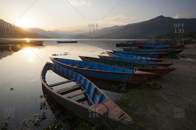 Traditional fishing boats along the shore of a lake