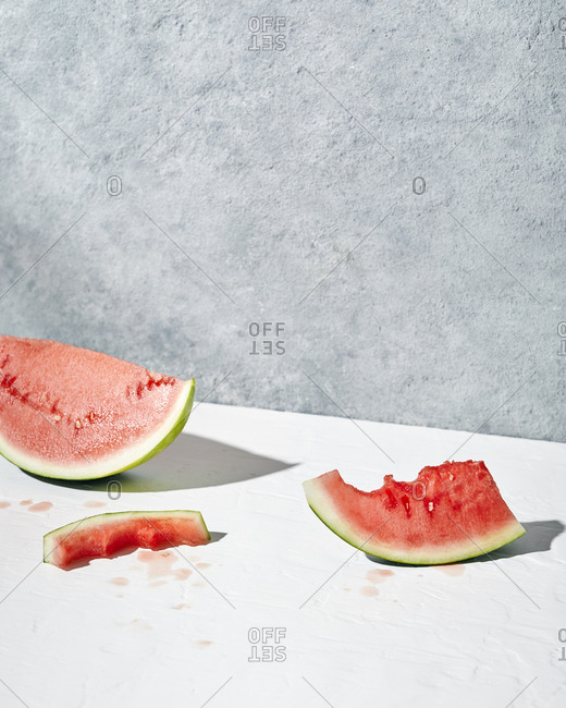 Bright slices on watermelon on a minimal concrete background