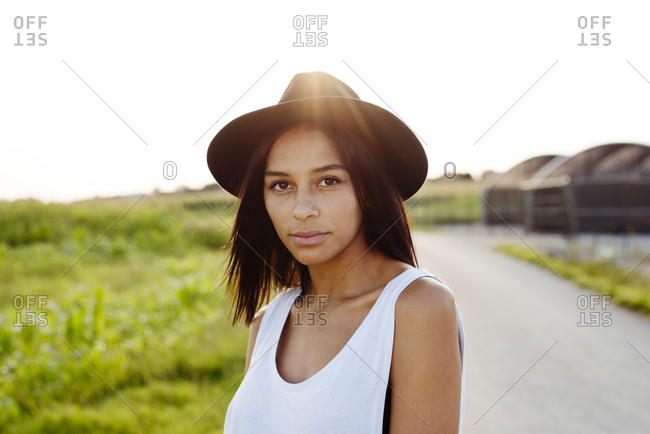 Cute black country girl with hat smiling and looking at the camera