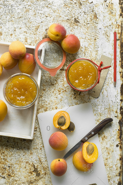 Two glasses of homemade apricot jam and apricots