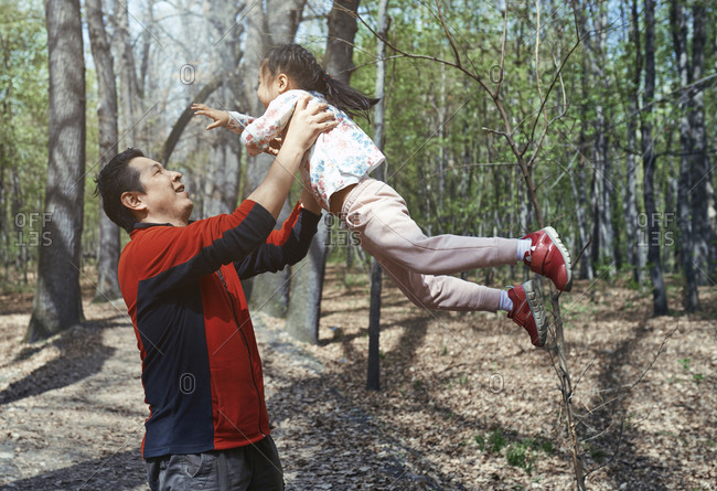 Father and daughter having fun in a park