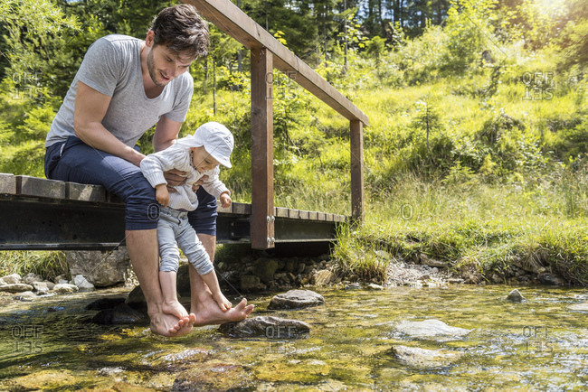 Father and daughter at Josefsthal mountain stream