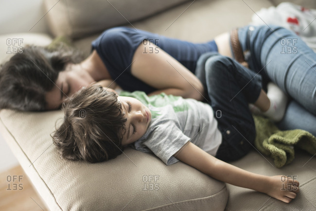 Mother and son taking a nap on couch